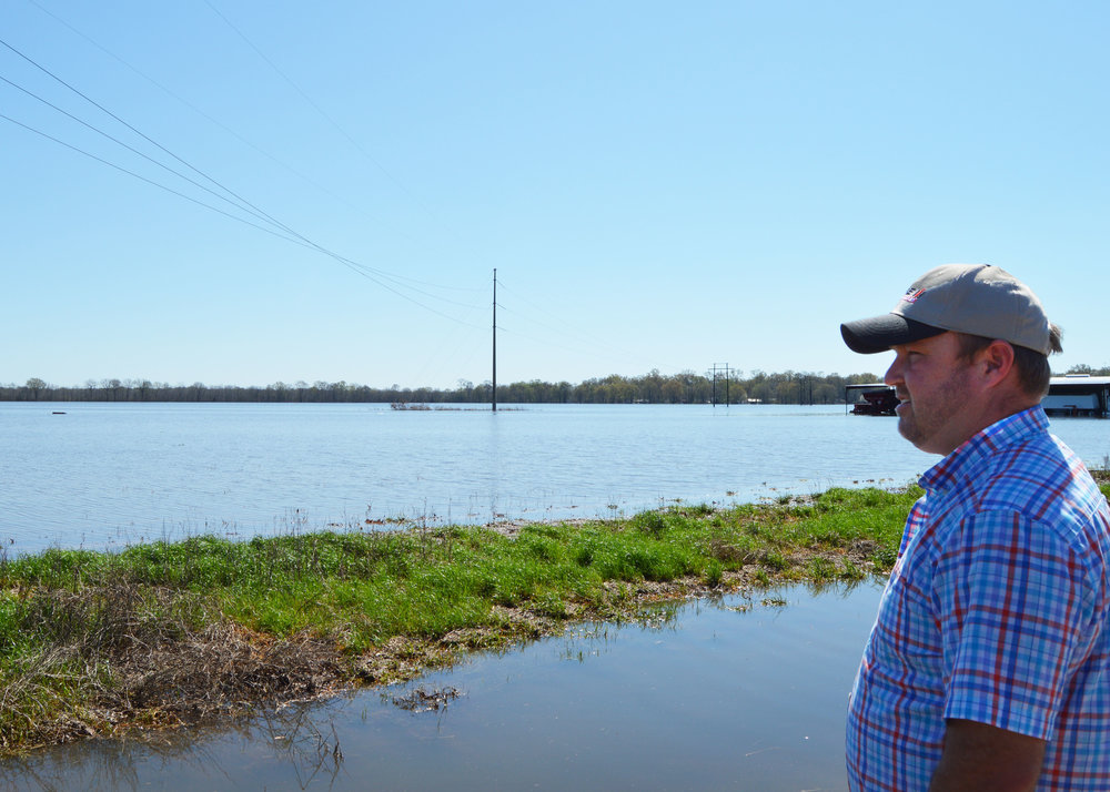 Farmer Chris Johnson looks at his corn crop underwater in Monroe, eastern Ouachita Parish.   A combine and other implements stranded in standing water off highway 165, north in Ouachita Parish.   A combine and other implements stranded in standing water off highway 165, north in Ouachita Parish.