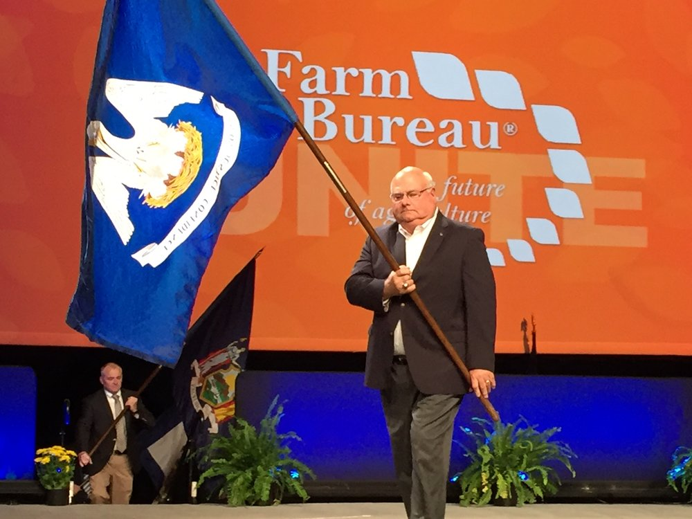 Louisiana Farm Bureau President Ronnie Anderson carried the Louisiana flag during the opening session of the American Farm Bureau Federation's annual convention in Phoenix, Arizona.
