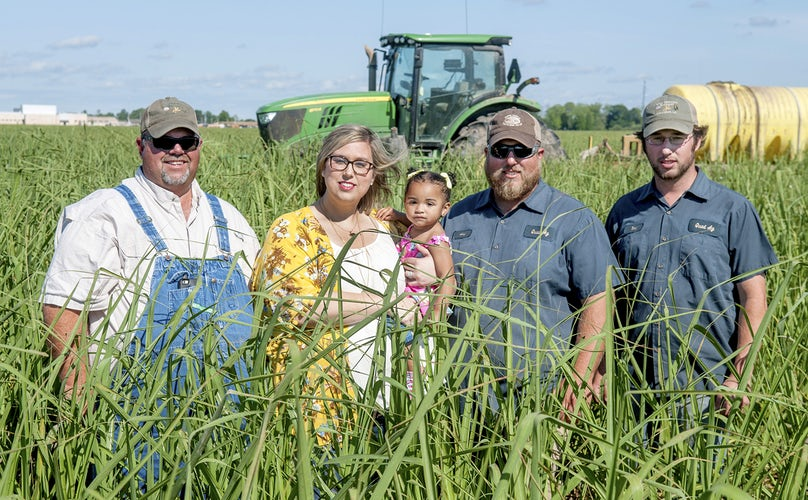Katie Sistrunk and her daughter Piper join her father and brothers on the family sugarcane and soybean farm in Iberville parish. Katie is the winner of the Louisiana Farm Bureau's 2017 Excellence in Agriculture Award. Photo by the Greater Baton Rouge Business Report.