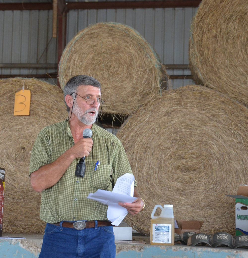 Keith Collins, LSU AgCenter county agent in Richland Parish, gives details on a hay study he conducted at the Goldmine Plantation during a beef and forage field day on Sept. 21. Photo by Bruce Schultz/LSU AgCenter
