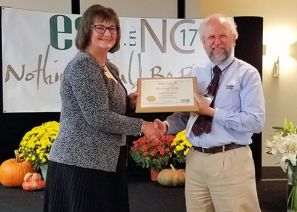 LSU AgCenter nematologist Charles Overstreet receives the Epsilon Sigma Phi Southern Region award for International Service from Kathleen Tweeten, Epsilon Sigma Phi national president. Photo provided by Lawrence Datnoff