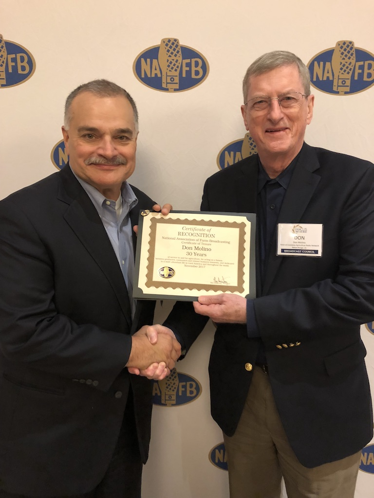 National Association of Farm Broadcasting President Max Armstrong (L) presents Louisiana Farm Broadcaster Don Molino (R) with a 30-year certificate for three decades of service to the farm broadcasting industry.