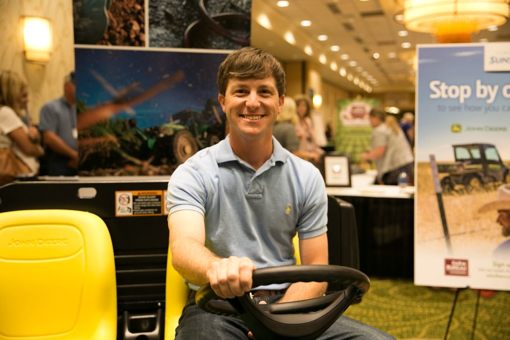 2018 Louisiana Farm Bureau Young Farmers and Ranchers Discussion Meet Winner Stephen Simoneaux sits on his new John Deere Gator.