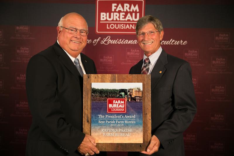 Rapides Parish Farm Bureau President Bill Cheek (right) accepts the 2018 Louisiana Farm Bureau President's Award from Louisiana Farm Bureau President Ronnie Anderson (left).