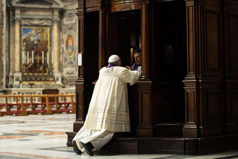 Pope Francis goes to Confession during a penitential celebration at St. Peter's Basilica, March 28, 2014. Credit: Ansa/L'Osservatore Romano.