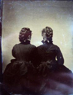 Two women facing away vintage photo.