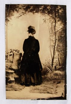 Vintage photo of Victorian woman facing away.