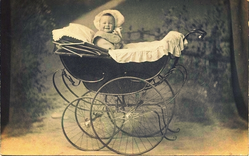 Baby in Antique Carriage. (Photo in Public Domain)