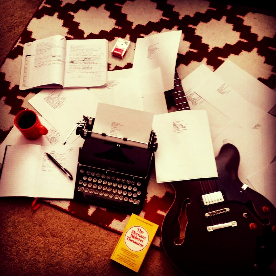 Typewriters, Guitar, Notes. Photo by Zach Nelson from THE NAPKIN CHAPTERS, poet from South Dakota.