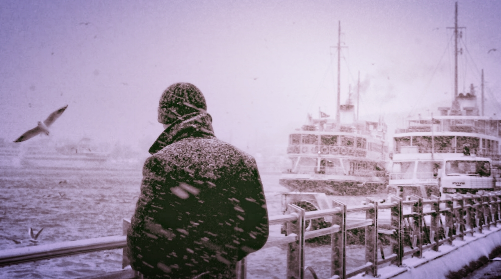 Man Standing in Cold Seaside (photo in public domain).