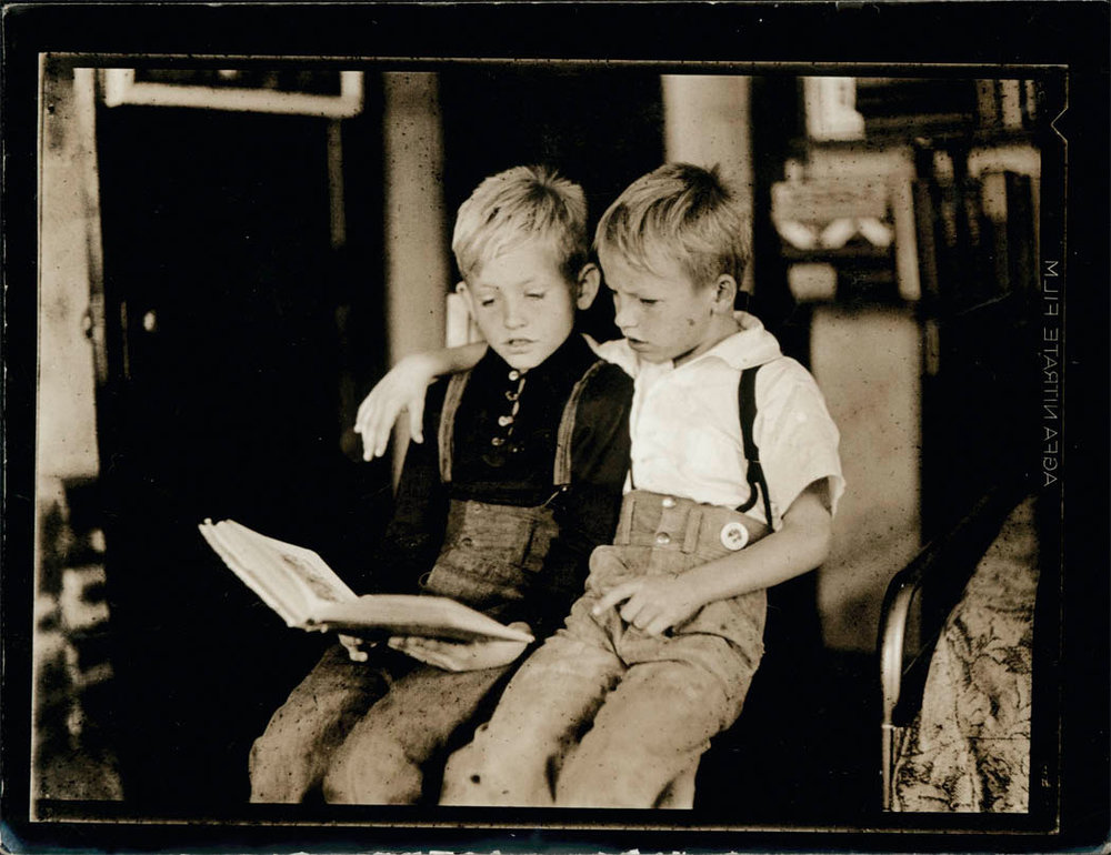 1920s Vintage Photo of Brothers Reading (Public Domain Image)