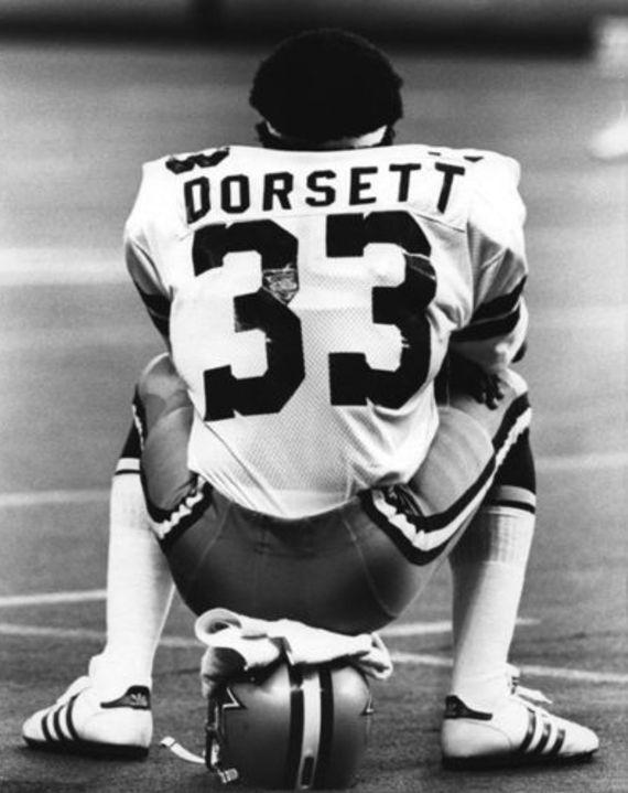 Dorsett seated on helmet.