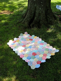 Classic English paper piecing using very large hexagons.