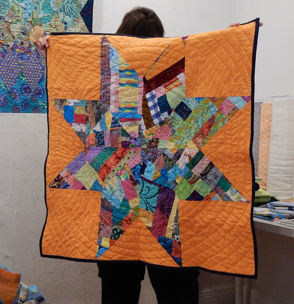"Patti made a lone-star quilt from scrappy improv ""made fabric"""