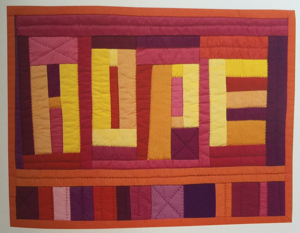 """Priority Hope"", 11.5 x 8.5, 2008. Designed, pieced and hand quilted by Tonya Ricucci."