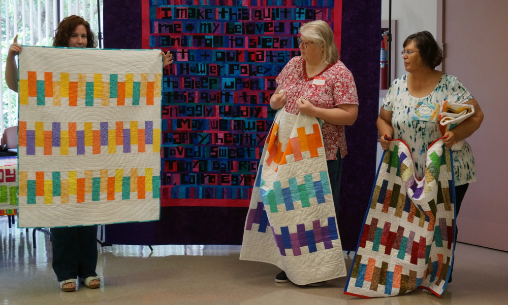 Four new quilt finishes for the community service project from Kerrilyn O'Rourke, Wanda Goldfarb and Patti Auten.