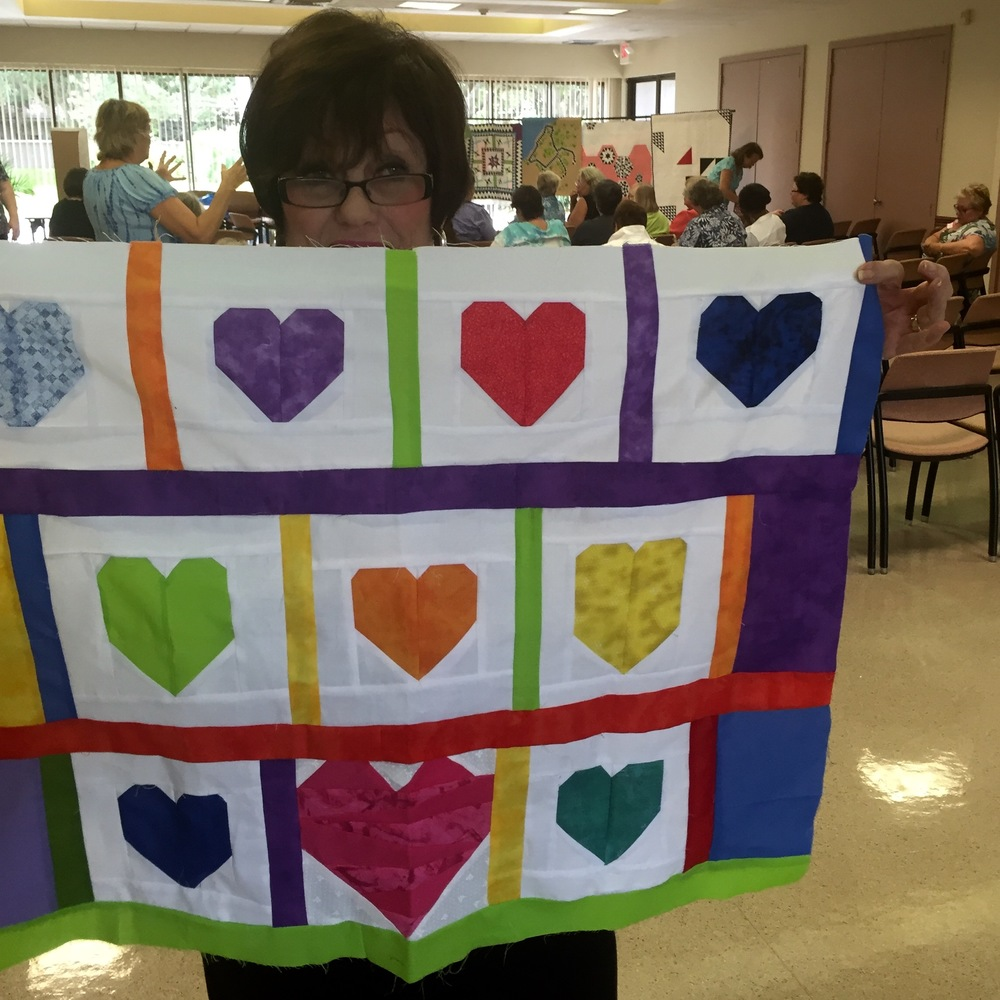 Member Marilyn Ehren sewing up love for Orlando.