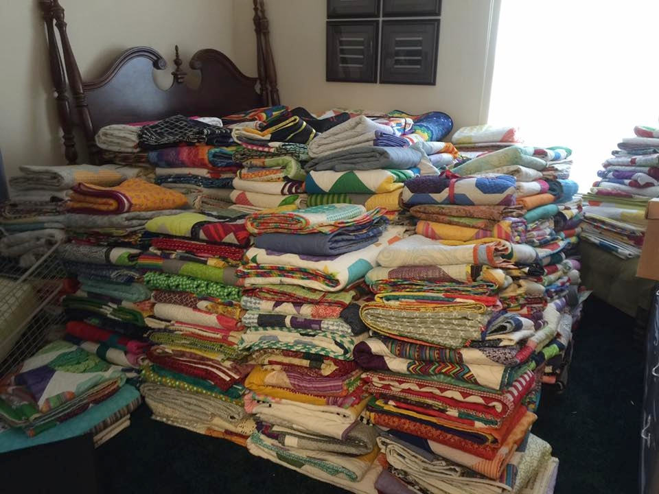 Rooms full of quilts donated from all over the world