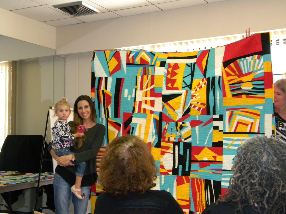 Patti's daughter, Marissa, and the raffle quilt