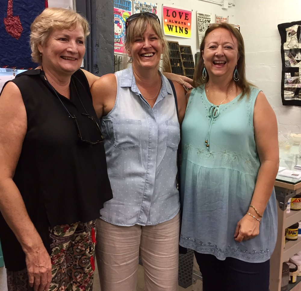 SFMQG member Karla with sister and Debby Schindall enjoying the exhibit opening.