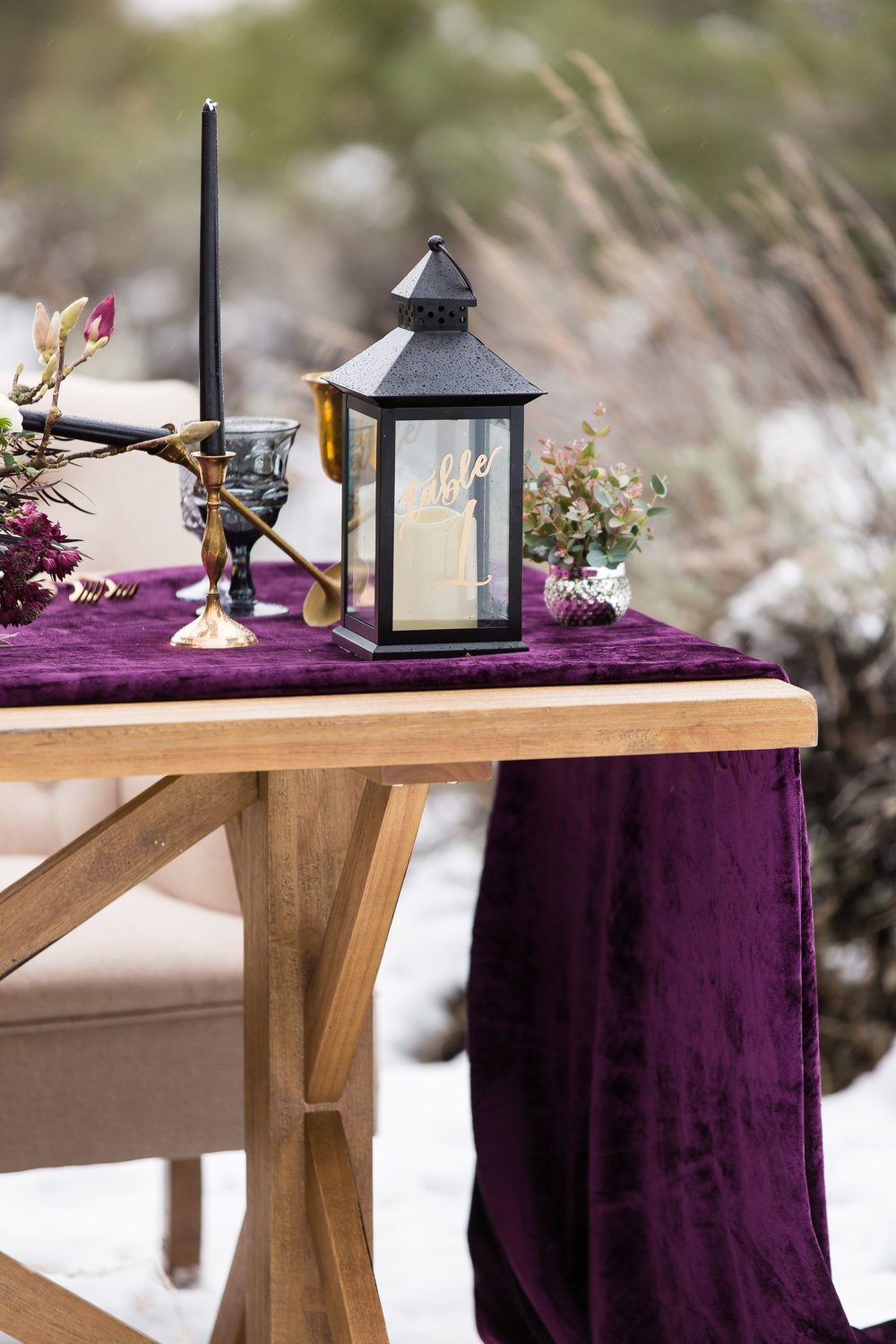 "For this moody winter styled shoot we choose colors that would pop against the white snow. Rich reds, purples, and black became the perfect palate. The beautiful bride transformed into an ""ice queen"" with a quartz crown. The flowers fit the stunning moody and bold vibe of this wedding styled shoot in Frazier Park, CA. #JAE #janealexandraevents #mountainweddingvenue #winterweddingplanning #californiawinterwedding"