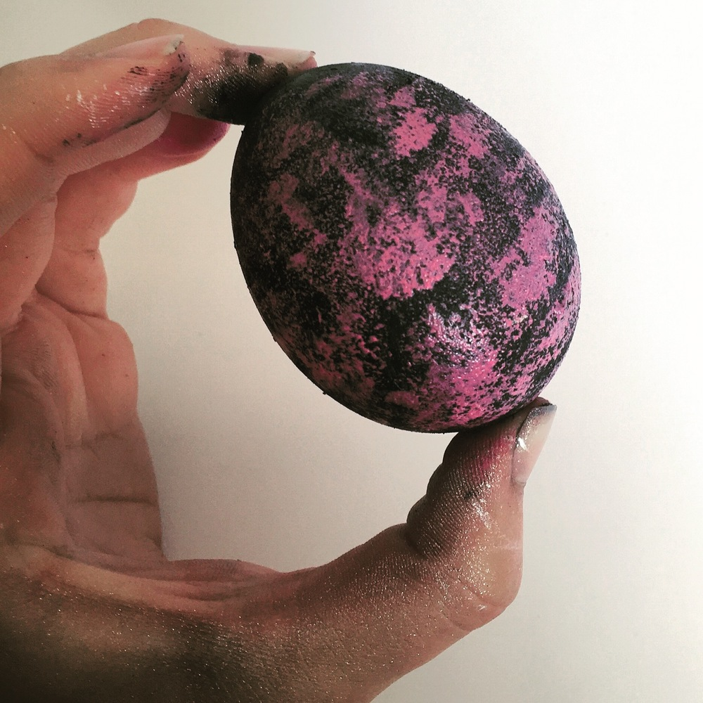 When the base color has dried, use the sponge brush to add your other layers of color on the egg (giving each layer some time to dry). We chose to sponge a layer of hot pink paint on to the egg!