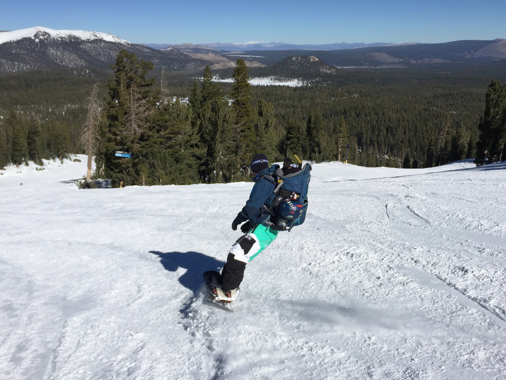 Enjoying the ride in the back pack ~ Baby snowboarder!
