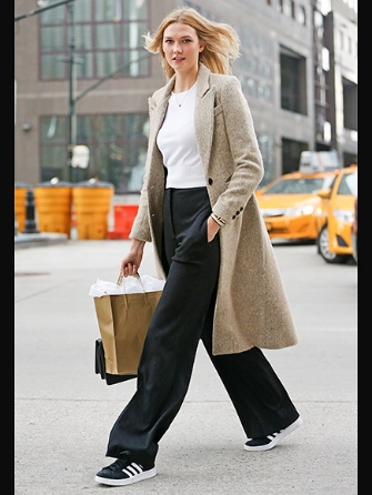 P.S. Here's the gorgeous Karlie Kloss in NY mixing her trousers with her tennis shoes. Love this look!  Photo credit People.com.
