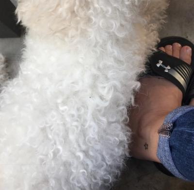 Me and my puppy nephew Sailor...he's keep my feet warm!