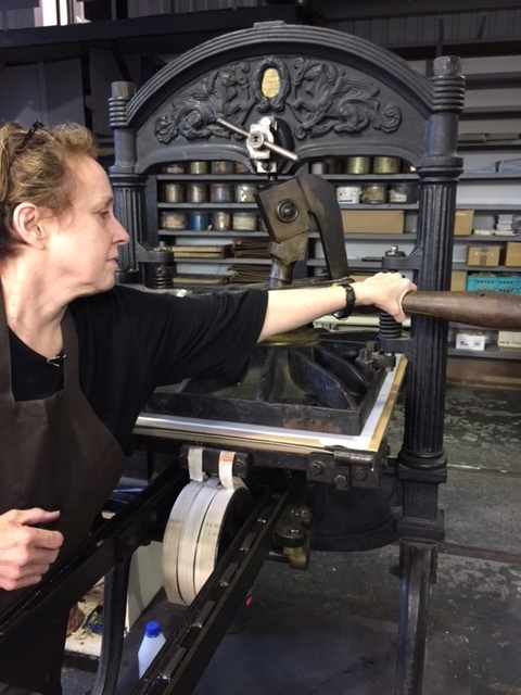 Using the historic press at the Estonian Paper and Print Museum.