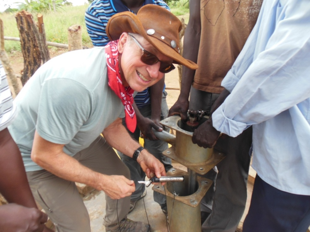 Tom inserts the first In-Situ transducer into the Moroto West well near Palbek, UG, in the far north.