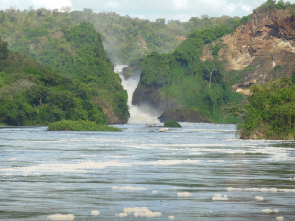 Murchison Falls on River Nile, where it crosses the western rift zone between Lake Kyoga and Lake Albert. This is one of the world's most powerful falls due to volume and pressure, as 300 cubic meters per second (10,500 cfs) is squeezed between a gap that's about 7 meters (23 feet) wide and tumbles 43 meters (141 feet) down.