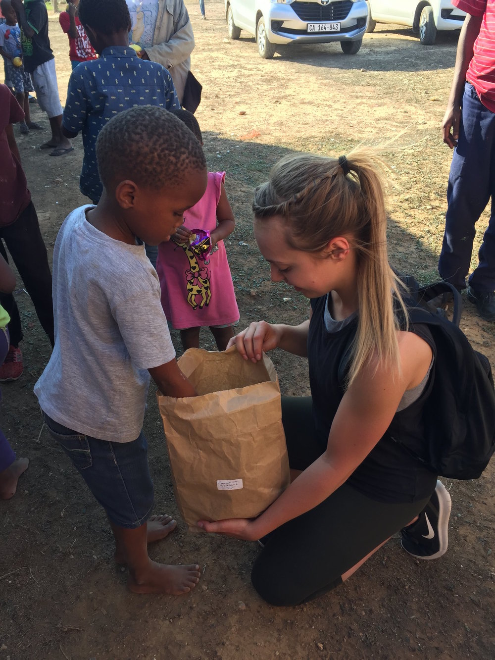 Alyssa distributing some snacks in Nomathamsanqa
