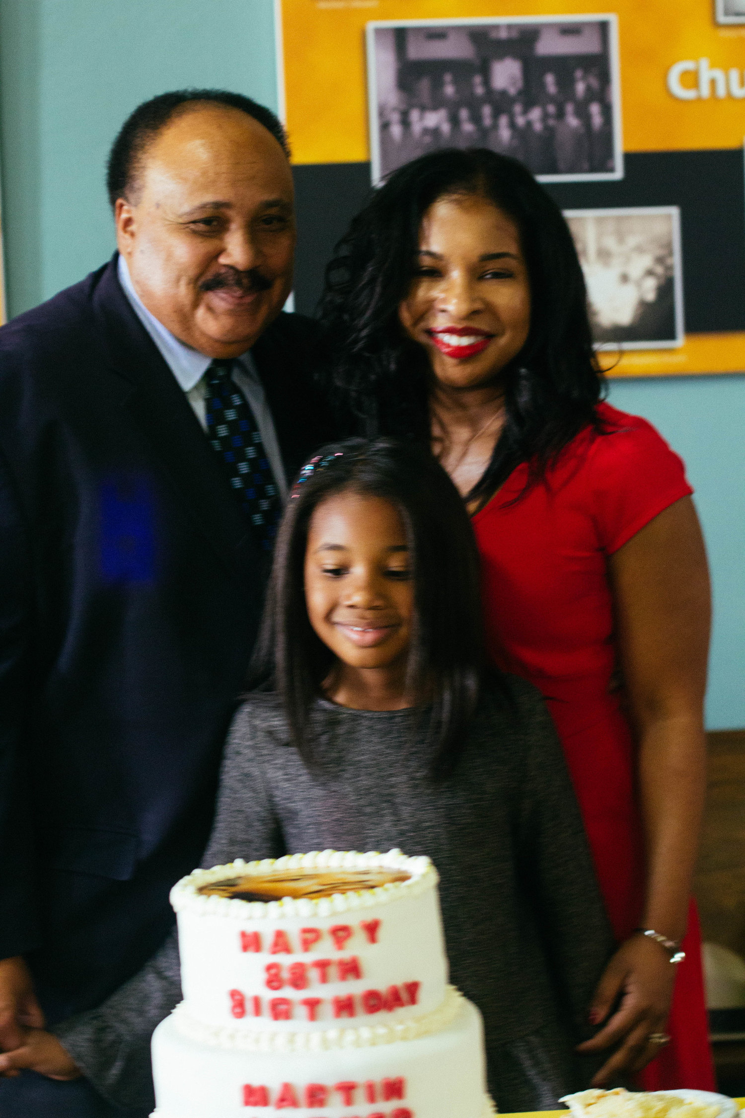 Martin Luther King III, his wife Arndrea KIng, and Yolanda Renee King preparing to cut MLK's 88th birthday cake