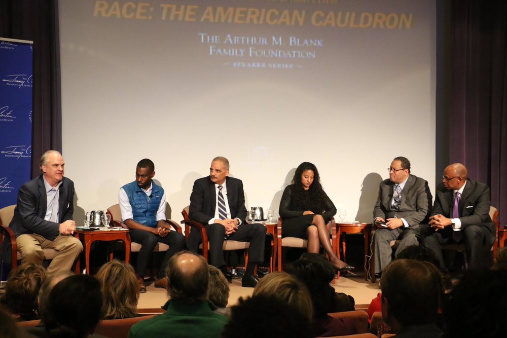 From left to right: Doug Blackmon, DeRay McKesson, Eric Holder, Elizabeth Hinton, Michael Eric Tyson, and Cedric Alexander
