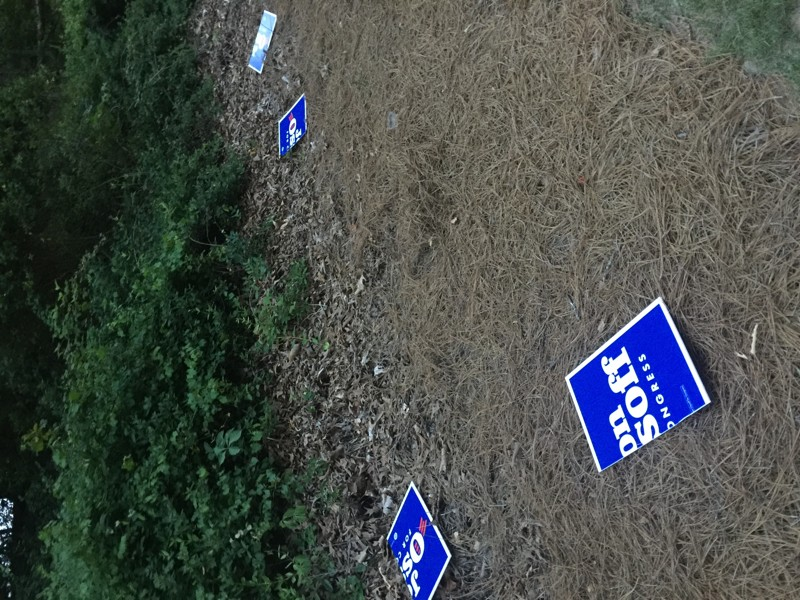 Vandalized Ossoff signage
