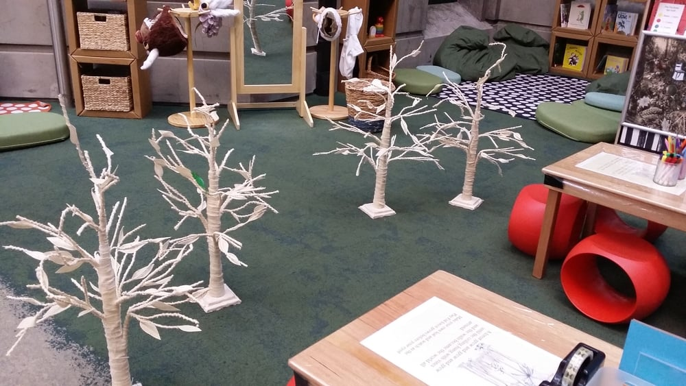 To encourage agency and community, children visiting the space are encouraged to add to various components, including these trees, which over time became an elaborate forest.