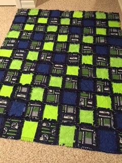 A Seahawks themed Quilt made by Colleen Vanderhoff.
