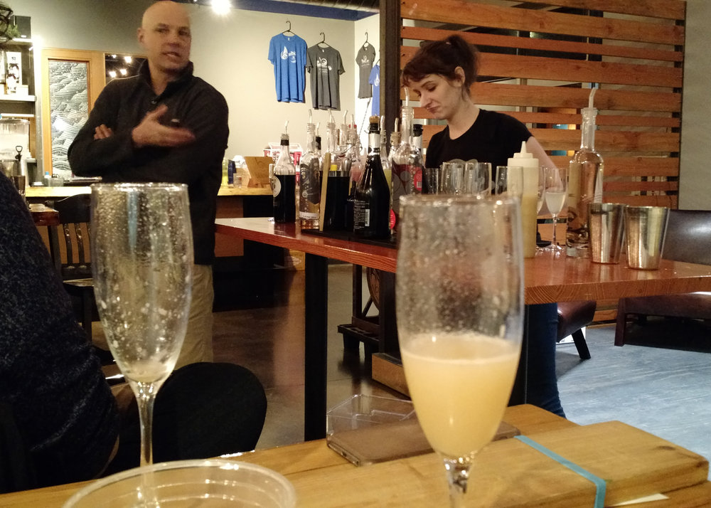 John and Maggie, mixing up pear puree, champagne, and other specialties.