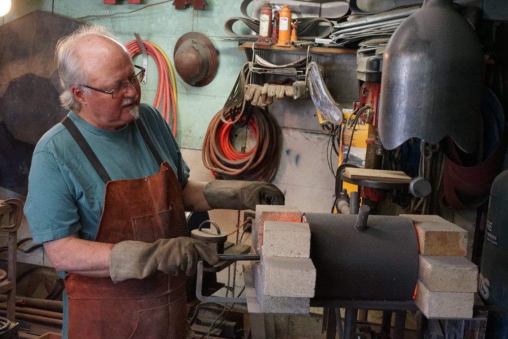Reg tempers steel in a propane-fueled forge // Richard Porter