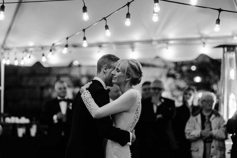 004-first-dance-under-string-lights-toronto-wedding-cottage.jpg