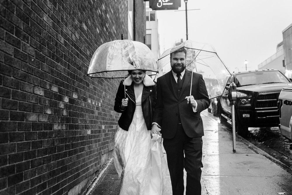 125-rainy-day-wedding-toronto-wedding-photographer-clear-umbrellas.jpg