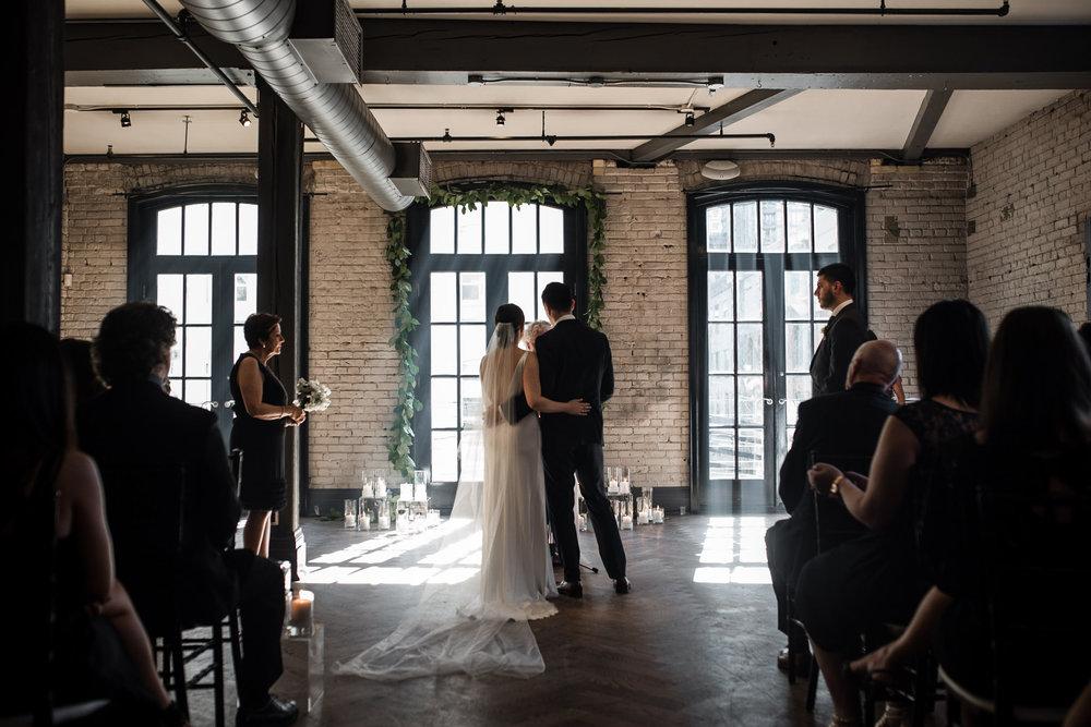 109-wedding-ceremony-storys-building-toronto-photographer-documentary.jpg