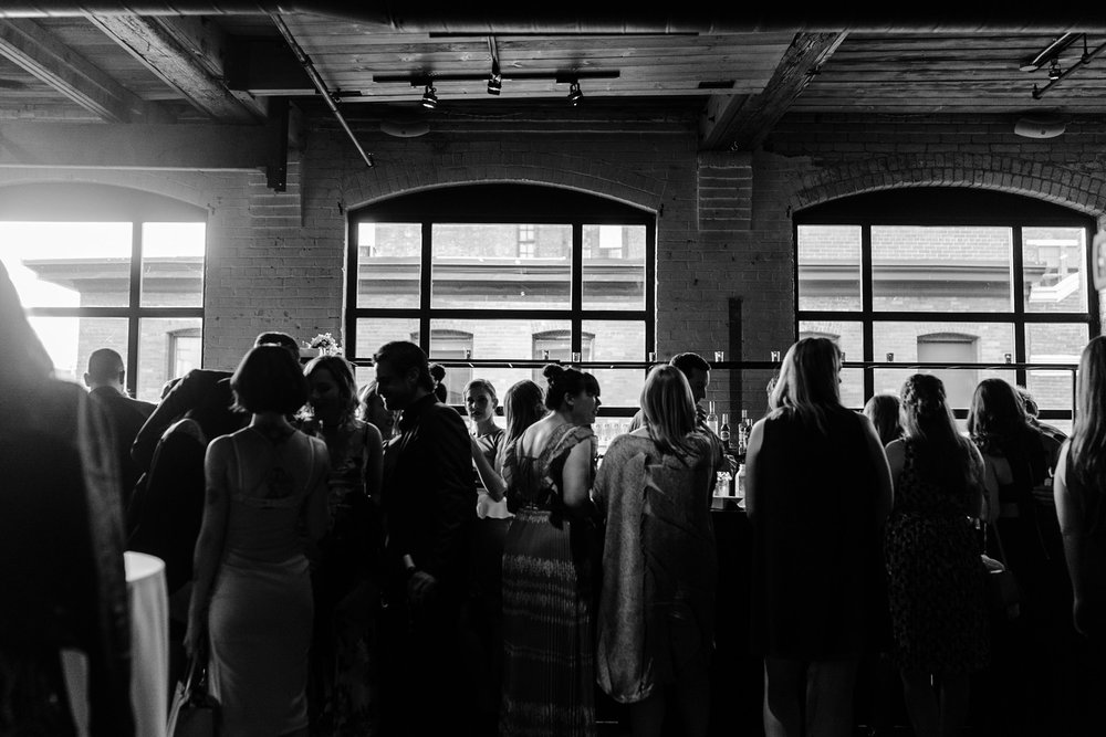 086-cocktail-hour-candid-toronto-industrial-building.jpg