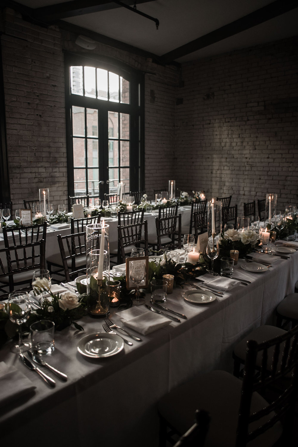 085-storys-building-reception-decor-candles-garland-romantic-industrial.jpg