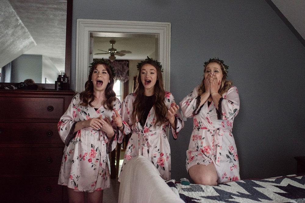 205-bridesmaids-reaction-to-brides-dress-getting-ready-toronto.jpg