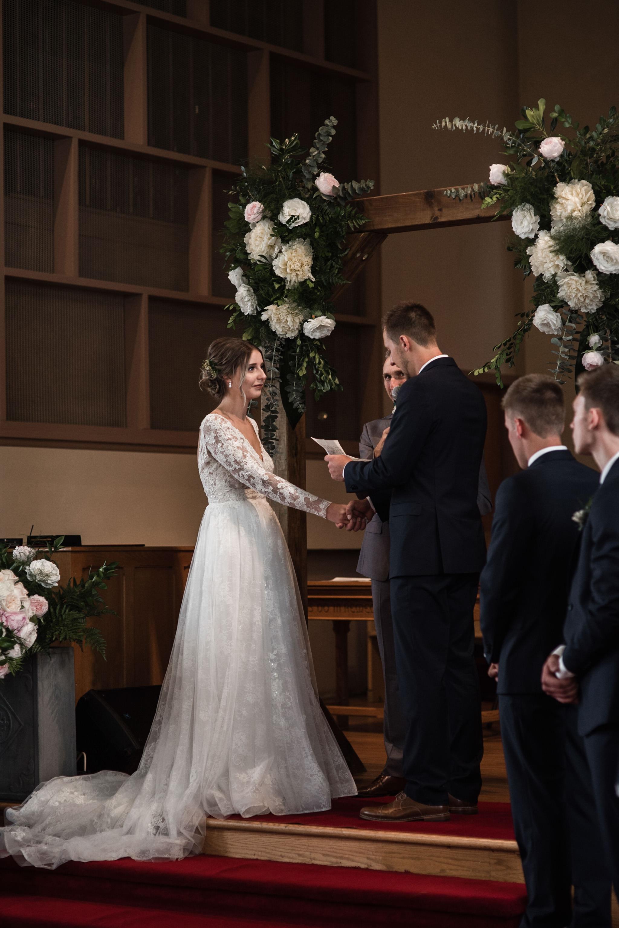 181-wedding-ceremony-candids-wooden-arch-in-church.jpg