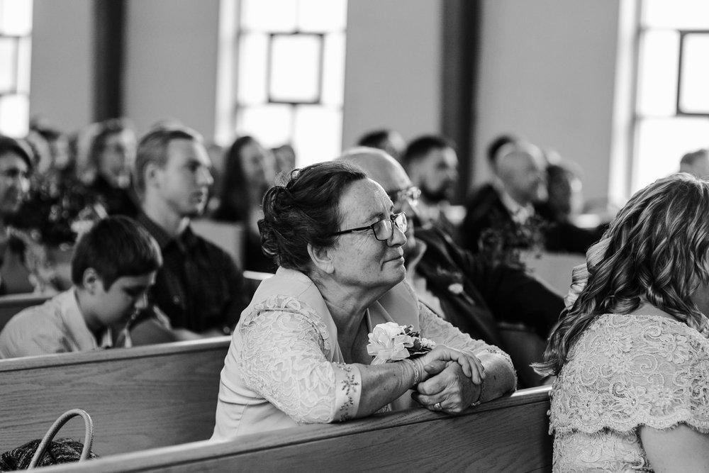 179-wedding-ceremony-candids-wooden-arch-in-church.jpg