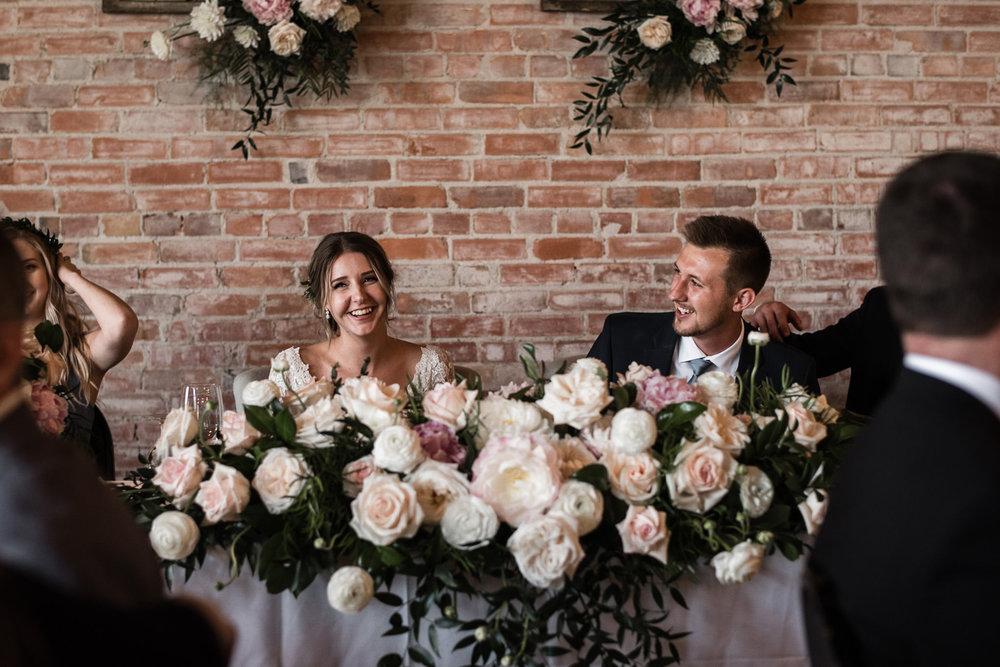 147-bride-groom-head-table-industrial-wedding-flowers-candids-arlington.jpg