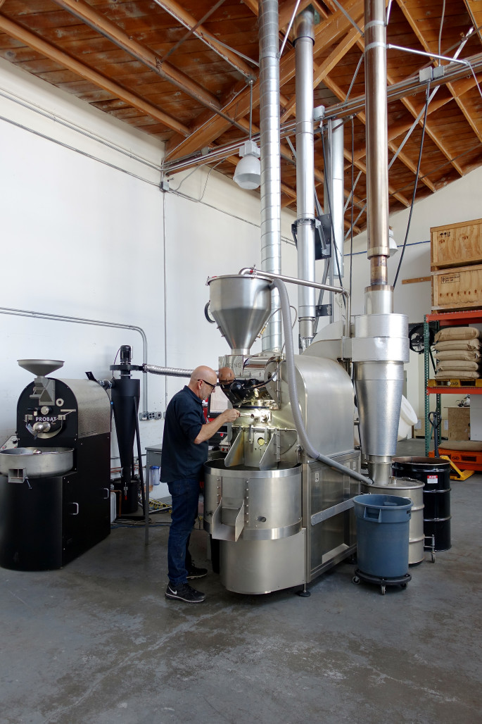 John Laird of Supersonic Coffee roasts beans at the Berkeley Co-Roasting facility. Photo: Supersonic Coffee